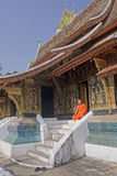 Monk at Wat Xieng Thong in Luang Prabang Stock Photo