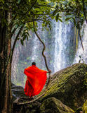 Monk at the waterfall Royalty Free Stock Images