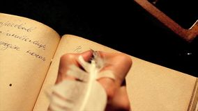 The monk writes with a goose quill the book