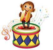 A monkey above a drum with cymbals Royalty Free Stock Photos