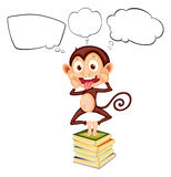 A monkey above the pile of books with empty callouts Royalty Free Stock Images