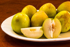 Monkey apples on white dish. Stock Images