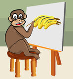 Monkey Artist. Monkey is painting banana on canvas with joy and fun Stock Photo