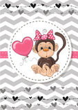 Monkey with balloon Stock Images