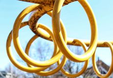 Monkey Bar Rings At The Park On A Sunny Day. Monkey Bar Rings in a loop At The Park for climbing On A Sunny Day Stock Images