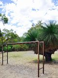 Monkey Bars in the Australian Bush. Kids monkey bars playground equipment in a nature Australian bushland setting under a blue sky with clouds Royalty Free Stock Photo