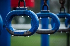 Monkey bars rings on a school playground at rainy day Royalty Free Stock Images