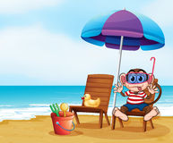 A monkey at the beach with toys Royalty Free Stock Photos
