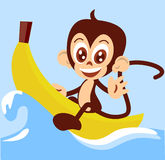 Monkey-boat. Cute little monkey is having a great time on his banana boat Stock Photography