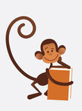 Monkey with book Royalty Free Stock Photos