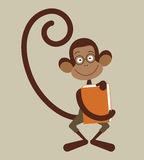 Monkey with book Stock Image
