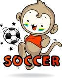 Monkey boy playing soccer joyfully.  Royalty Free Stock Photo