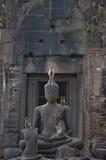 Monkey and buddha Royalty Free Stock Image