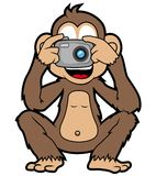 Monkey with camera. Happy monkey taking a photograph with his pocket camera Stock Images