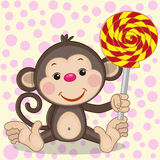 Monkey with candy Royalty Free Stock Photos