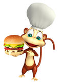 Monkey cartoon character with burger and chef hat Royalty Free Stock Photography