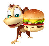 Monkey cartoon character with burger Stock Image