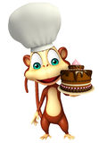 Monkey cartoon character  with cake and chef hat Stock Photos