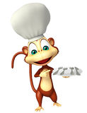 Monkey cartoon character with chef hat and dinner plate Stock Image