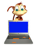 Monkey cartoon character with laptop Stock Images