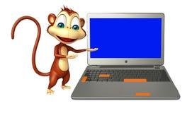 Monkey cartoon character with laptop Stock Photo