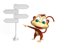 Monkey cartoon character with way sign Royalty Free Stock Images