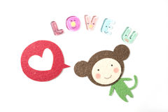 Valentine cartoon. Monkey cartoon saying love you with white heart for valentine Royalty Free Stock Photo