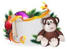 Monkey and Christmas wreath Stock Photo
