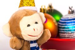 Monkey and  colorful balls in red vase Royalty Free Stock Images