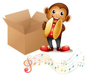 A monkey with cymbals beside a box with musical notes Royalty Free Stock Image