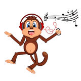 Monkey dance while listening to music with a headset cartoon Royalty Free Stock Images