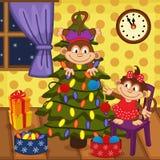 Monkey decorating Christmas tree Stock Image
