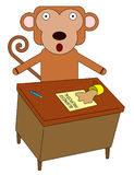 Monkey at desk Stock Photography