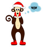 Monkey dressed as Santa Royalty Free Stock Images