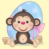Monkey with egg Royalty Free Stock Photo