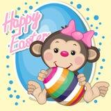 Monkey with egg Stock Photo