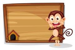 A monkey beside an empty board Stock Image