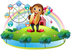 A monkey with a ferris wheel and balloons at the back Royalty Free Stock Photos