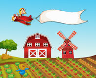 Monkey flying plane over farmyard Stock Images