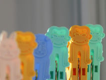 Monkey and friends. Colorful clothespins sticking to clothesline Royalty Free Stock Image