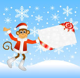 Monkey with a gift card Royalty Free Stock Image