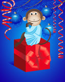 Monkey and gift Royalty Free Stock Image
