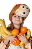 Monkey girl with fruit Royalty Free Stock Photo