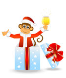 Monkey with a glass of champagne in a gift box Stock Image