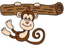 Monkey hanging on the tree trunk Stock Photos