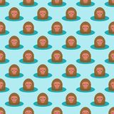 Monkey head character seamless pattern background animal wild zoo ape chimpanzee vector illustration. Royalty Free Stock Photo