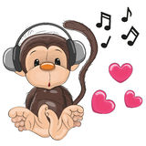 Monkey with headphones Royalty Free Stock Image