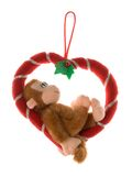Monkey on a heart Royalty Free Stock Photography