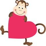 Monkey on heart shaped Stock Photo