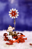 Monkey holding a Christmas wreath in the hands of a snowflake. Royalty Free Stock Photography